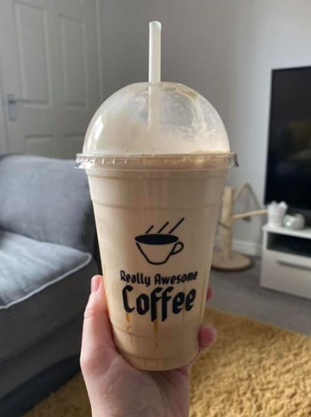 Caramel frappe in a branded cup with a straw