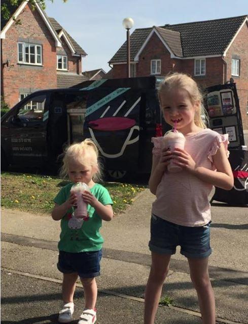 Happy children enjoying strawberry milkshakes